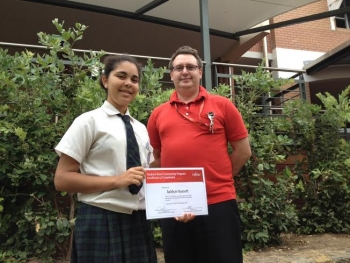 Ashlyn Hassett receives her certificate from Fujitsu's WA Service Desk Manager Warren Brickett