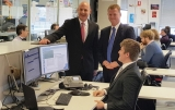 Tasmanian Treasurer, Peter Gutwein (left) with DXC's Head of Service Desk, John Schumacher at the DXC Service Desk Centre of Excellence in Hobart