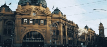 The Flinders Street railway station, an iconic building housing in Melbourne the city where Nexia has its offices.