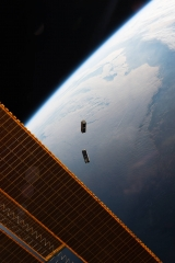 NASA photo showing CubeSats flying free after leaving the International Space Station
