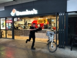 Pizza delivery on the run at Dominos Pizza Ferny Grove, Brisbane store