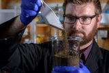 Associate Professor Justin Chalker at work with the sulfur-based polymer.