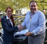Samantha Taylor of the Australian Road Research Board handing over the phase 1 report of the EastLink survy to Emiliyan Gikovski of VicRoads.