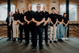 The Emrod team line up behind Greg Kushnir to mark the launch of their 'world first' wireless power transmission tech