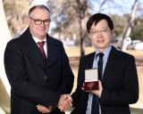 Curtin University Deputy Vice-Chancellor Research Professor Chris Moran and Professor Brad Yu with his John Booker Medal.