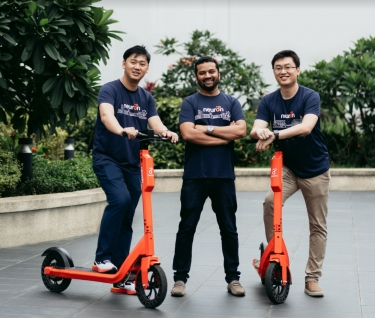Neuron Mobility co-founders Zachary Wang, left, and Harry Yu, right, with Square Peg partner Tushar Roy